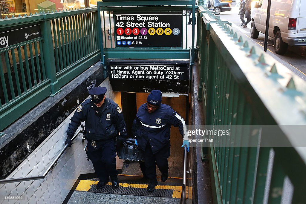 The body of an apparent suicide victim is brought up from a subway station in Times Square on January 22, 2013 in New York City. New York City has been experiencing a rash of high-profile incidents involving individuals being hit by trains in suicides, accidents and people being pushed to their deaths.