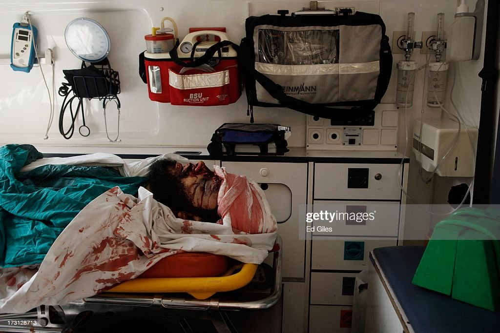 The body of an Egyptian man lies in an ambulance after allegedly being killed during a shooting at the site of a pro-Morsi sit-in in front of the headquarters of the Egyptian Republican Guard, at the Liltaqmeen al-Sahy Hospital in Cairo's Nasr City district on July 8, 2013 in Cairo, Egypt. Egyptian health ministry officials are reporting at least 42 people were killed and more than 300 injured in the incident early on Monday morning, which allegedly occurred as supporters of deposed Egyptian President Mohammed Morsi attending the sit in were performing dawn prayer. The demonstrators were demanding the release of Morsi, who they believe is being held inside the Republican Guard headquarters.