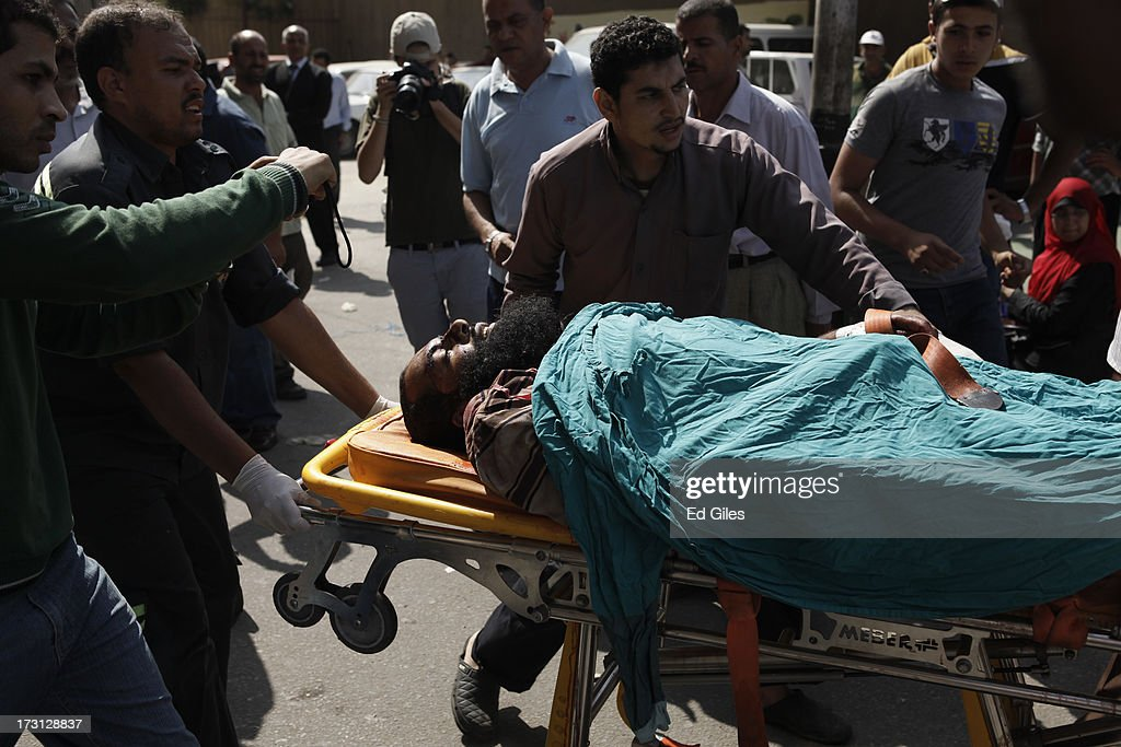 The body of an Egyptian man lies on a stretcher at the Liltaqmeen al-Sahy Hospital in Cairo's Nasr City district, after allegedly being killed during a shooting at the site of a pro-Morsi sit-in in front of the headquarters of the Egyptian Republican Guard on July 8, 2013 in Cairo, Egypt. Egyptian health ministry officials are reporting at least 42 people were killed and more than 300 injured in the incident early on Monday morning, which allegedly occurred as supporters of deposed Egyptian President Mohammed Morsi attending the sit in were performing dawn prayer. The demonstrators at the sit in were demanding the release of Morsi, who they believe is being held inside the Republican Guard headquarters.