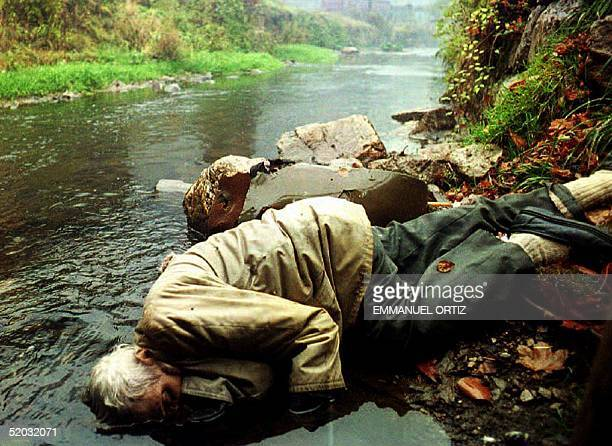 VARES BIH NOVEMBER 5 The body of an elderly man slain by a single bullet in the chest lies on the riverbank in Vares 05 November 1993 in...