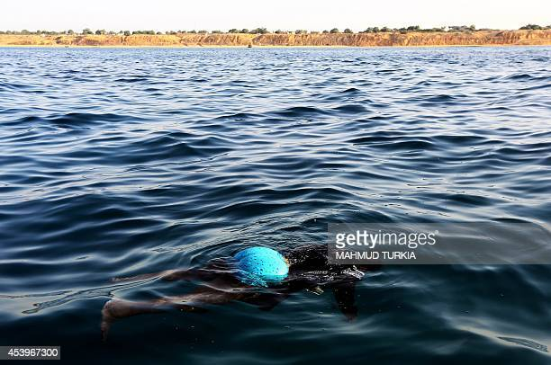 The body of an illegal immigrant floats on the water after a boat carrying 200 illegal migrants from subSaharan Africa sank off the shores of...