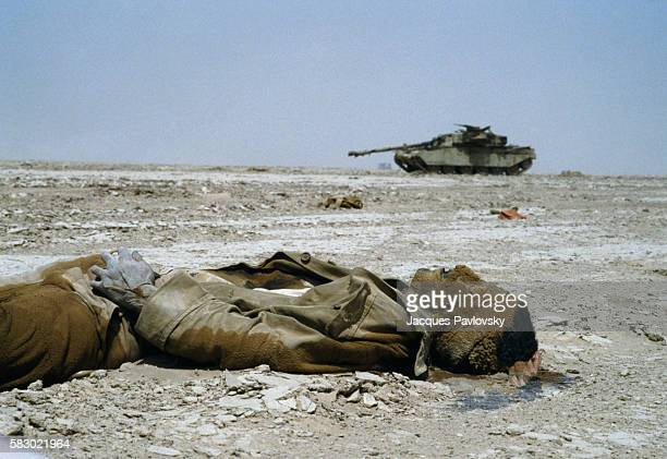The body of an Iranian soldier and burnt out tank following combat that took place around Basra in southern Iraq in 1982 The war between Iran and...