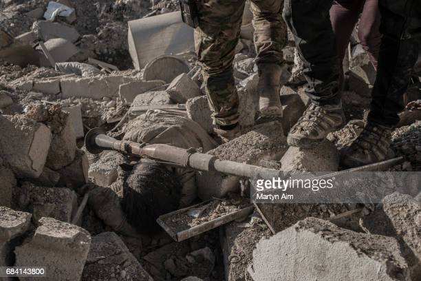 The body of an Islamic State fighter killed by Iraqi Counter Terrorism Service soldiers in Aden a suburb of Mosul An RPG a rocketpropelled grenade...