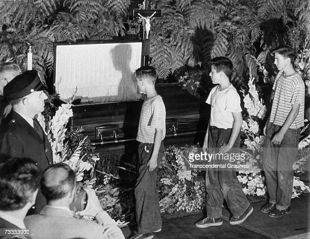 NEW YORK AUGUST 17 1948 The body of Babe Ruth lies in an open casket in Yankee Stadium on August 17 as a crowd of young fans passes by
