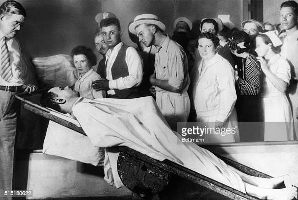 The body of bank robber John Dillinger is put on display in a Chicago morgue after he is shot to death by the FBI and police