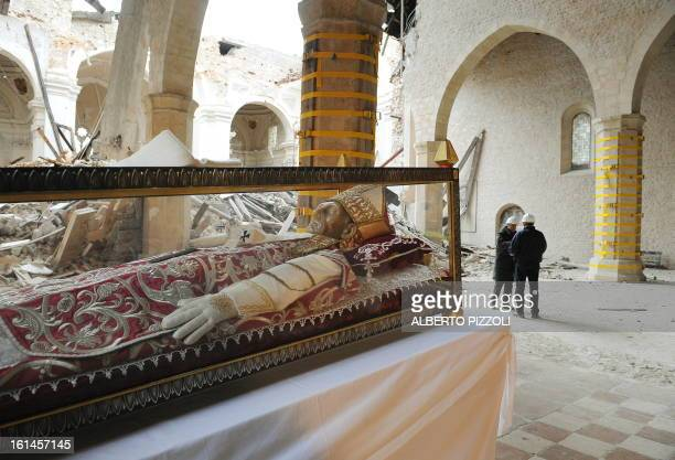 The body of Celestine V is seen at the Collemaggio Basilic after Pope Benedict XVI put on the urn a white stole reminiscent of his visit in L'Aquila...