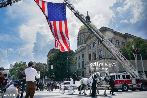 The body of civil rights leader C.T. Vivian is carried past the Georgia Capitol building in a horse-drawn carriage on July 22, 2020 in Atlanta,...