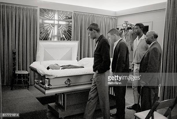 The body of slain Negro leader Dr Martin Luther King lies in state at a local funeral home here on April 5th as young men file by to pay their last...