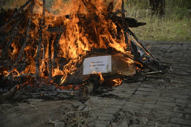 The body of construction worker Surjeet Mainka who was killed in Iraq is cremated in Chuhar Wali village on the outskirts of Jalandhar on April 3...