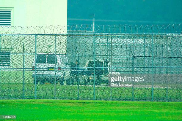 The body of convicted killer Aileen Wuornos is loaded into a hearse at the Florida State Prison following her execution by lethal injection October 9...