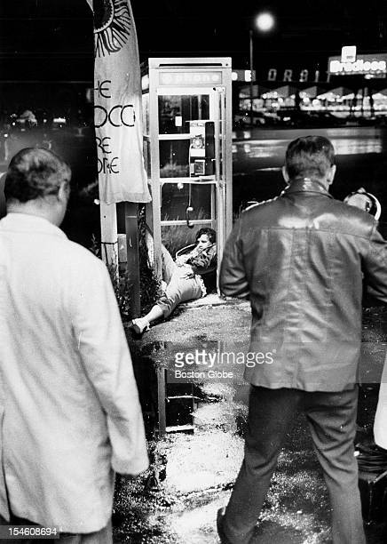 The body of Eddie Connors of Savin Hill Dorchester lies in a phone booth on Morrissey Boulevard after being slain by shotguns on June 12 1975...