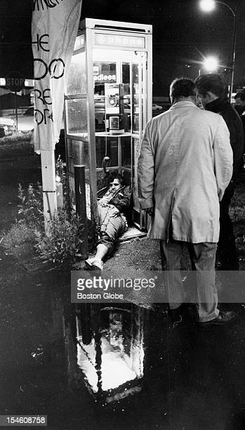 The body of Eddie Connors of Savin Hill Dorchester lies in a phone booth on Morrissey Boulevard after being fatally shot June 12 1975 District 11...