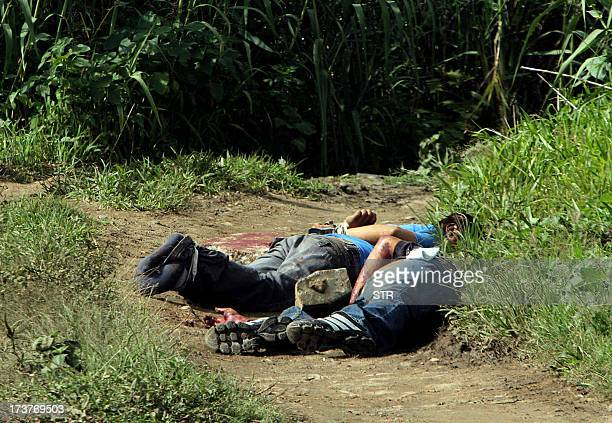 The body of El Imparcial newspaper photojournalist Alberto Lopez Bello lies next to an unidentified one in a cornfield of La Humedad in the...