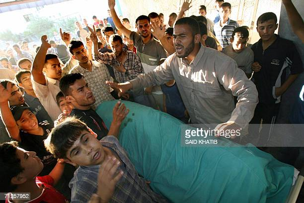 The body of Fatima alBarbarawi is brought to the Naser hospital in the southern Gaza Strip town of Khan Yunis 21 June 2006 following an Israeli air...