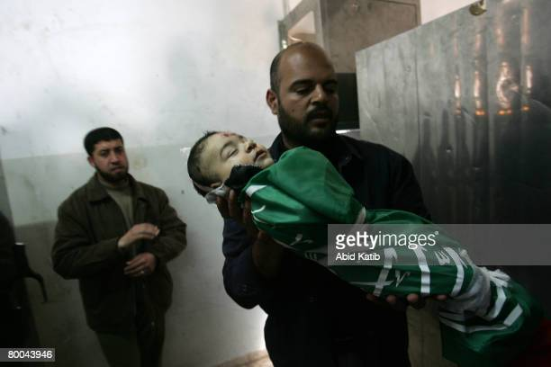 The body of fivemonth old Mohammad Naser AlBuri is carried by a relative during his funeral February 28 2008 in Gaza City Gaza AlBuri who is the son...