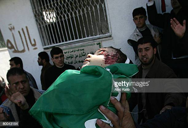 The body of fivemonth old Mohammad Naser AlBuri is carried by his father during his funeral February 28 2008 in Gaza City Gaza AlBuri who is the son...
