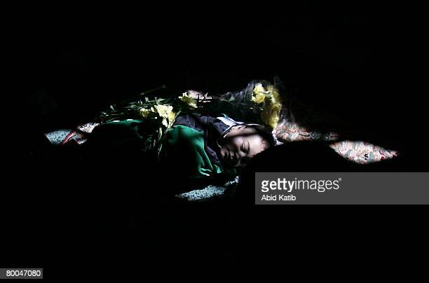 The body of fivemonth old Mohammad Naser AlBuri lies at the mosque during his funeral February 28 2008 in Gaza City Gaza AlBuri who is the son of the...