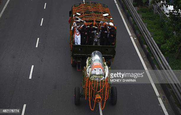 The body of former Indian president APJ Abdul Kalam is transported from the airport to his house in New Delhi on July 28 2015 India's former...