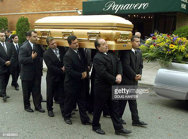 The body of former mob boss John Gotti is carried from Papavero Funeral Home in the Queens borough of New York 15 June 2002 John Gotti flamboyant...