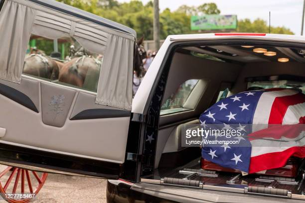 The body of former US Rep John Lewis is placed into a hearse after it was carried across Edmund Pettus Bridge on July 26 2020 in Selma Alabama On the...