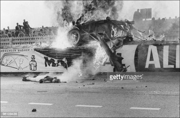 The body of French pilot Pierre Levegh lies dead after his Mercedes Benz 300 SLR hit the stands and exploded on June 11 1955 during the 23th edition...