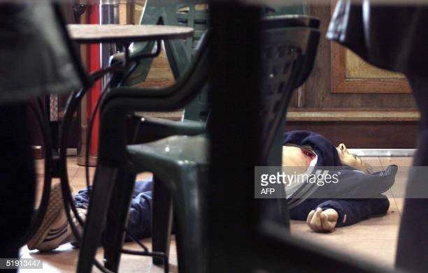 "The body of Giovanni Urzini lies on the floor of the ""Champs-Elysees"" bar, suburb Naples, 04 January 2005 after being shot dead. Italian President..."