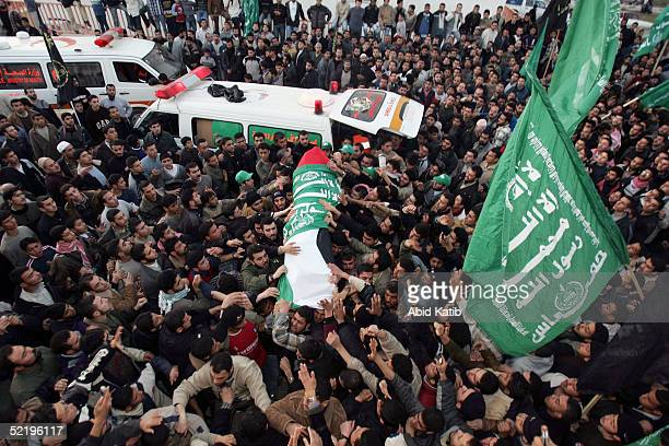 The body of Hamas fighter Emad Almansy one of 15 dead Palestinian militants to be returned by Israel is carried by the crowd as it arrives at the...