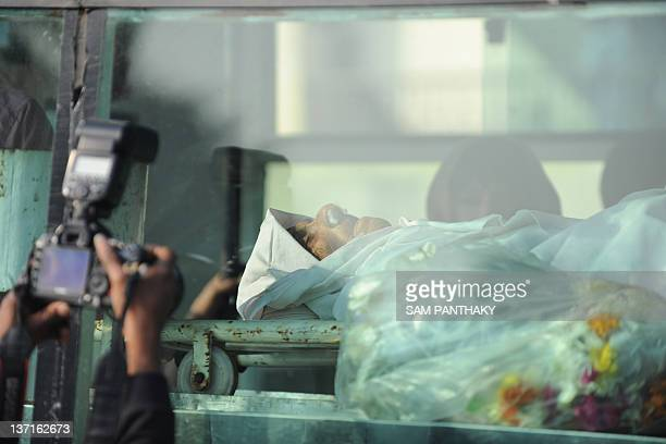 The body of Homai Vyarawalla India's first female photojournalist is brought for cremation in Vadodara some 110 kms from Ahmedabad on January 16 2012...