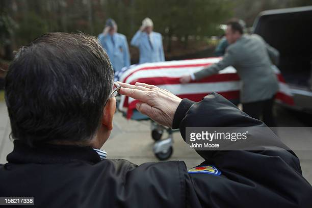 The body of Hurricane Sandy victim David Maxwell arrives for burial at the Calverton National Cemetery on December 11 2012 near the Wading River...