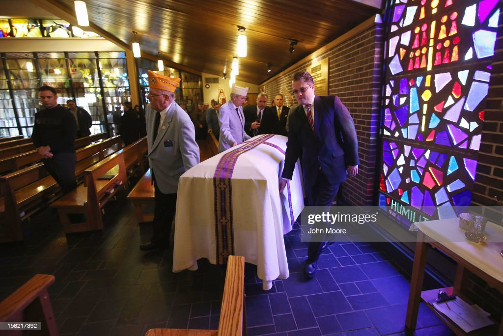 The body of Hurricane Sandy victim David Maxwell is brought into the St. Charles Catholic Church for his funeral on December 11, 2012 in the Staten Island borough of New York City. Maxwell, 66, was the last of Sandy's victims found on Staten Island, when his body was discovered in his home 11 days after the storm. A Vietnam veteran with the U.S. Navy, he was buried at the Calverton National Cemetery, accompanied by honor guards from the Catholic War Veterans and the Patriot Guard Riders.