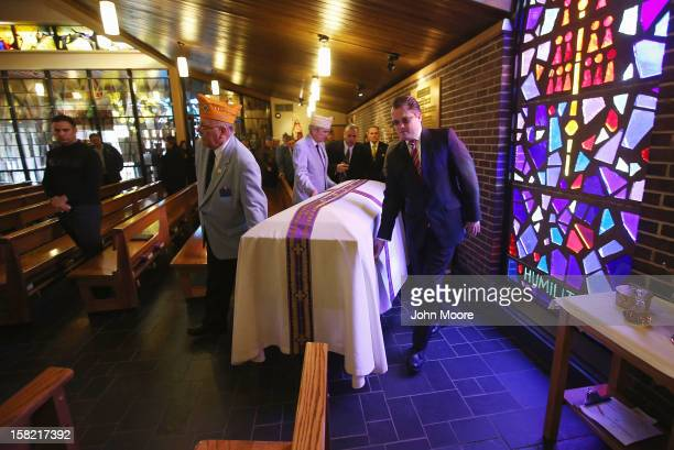 The body of Hurricane Sandy victim David Maxwell is brought into the St Charles Catholic Church for his funeral on December 11 2012 in the Staten...