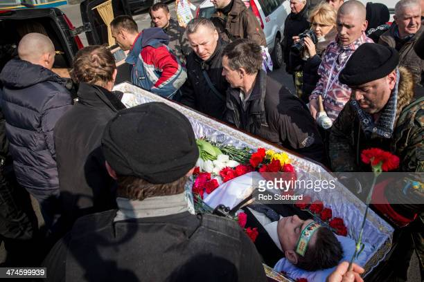 The body of Igor Alexandrovich from Vish Horod is carried towards a hearse in Independence Square on February 24 2014 in Kiev Ukraine Ukrainian...