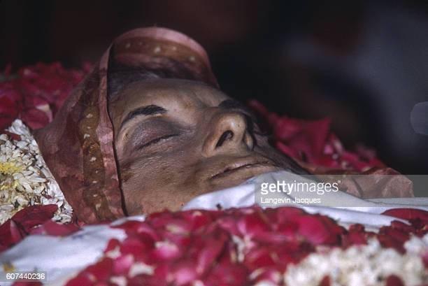 The body of Indira Gandhi lies in state following her assassination on October 31 1984 Gandhi was the Prime Minister of India who was assassinated by...