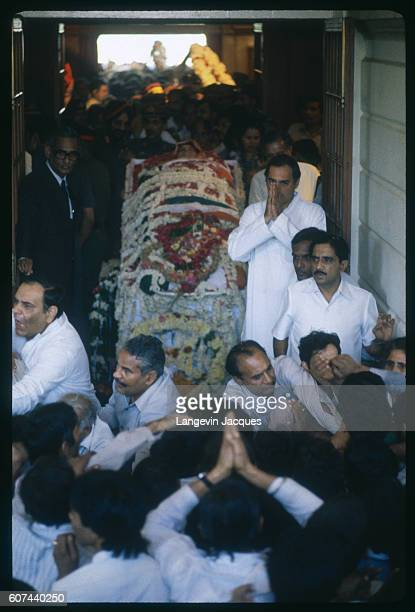 The body of Indira Gandhi lies in state following her assassination on October 31 surrounded by mourners including her son Rajiv Gandhi Indira Gandhi...