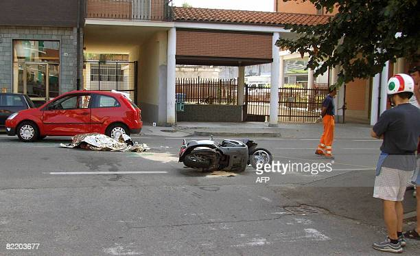 The body of Italian Andrea Pininfarina CEO of the famed Italian car design firm lies on the street after he died in an road accident in...