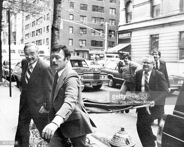 The body of John Lennon is taken into Frank E. Campbell funeral home, Madison Ave. And 81st St. In body bag.