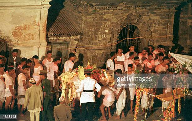 The body of King Birendra of Nepal is carried to his funeral pyre June 2 2001 at the Pashupati Nath Arya Ghat complex in Kathmandu Nepal Several...