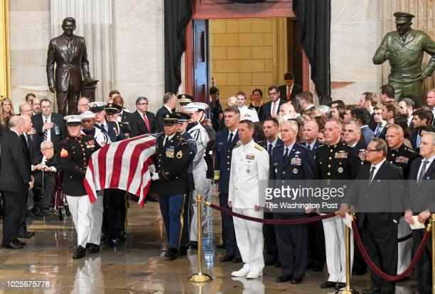 The body of lateSen John S McCain arrives to lie in state during a ceremony to honor the sixterm senator from Arizona in the Capitol Rotunda on...