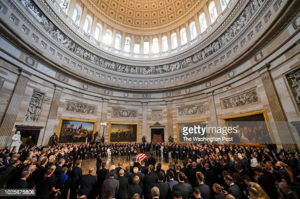 The body of lateSen John S McCain lies in state during a ceremony to honor the sixterm senator from Arizona in the Capitol Rotunda on Friday He is...