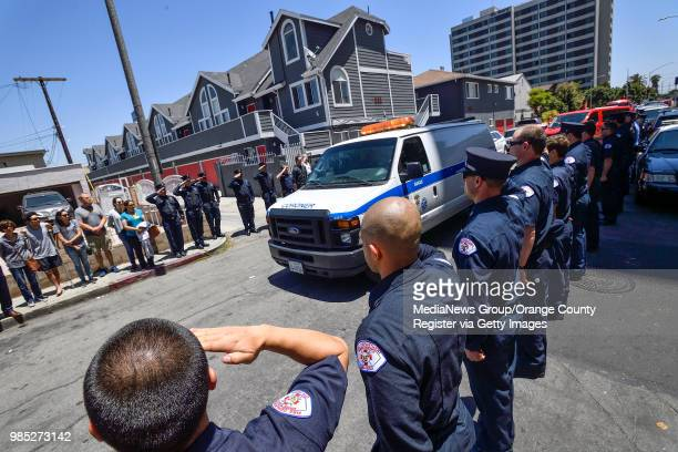 The body of Long Beach Long Beach Fire Department Capt Dave Rosa leaves St Mary Medical Center inside a coroner's van after he was shot and killed...