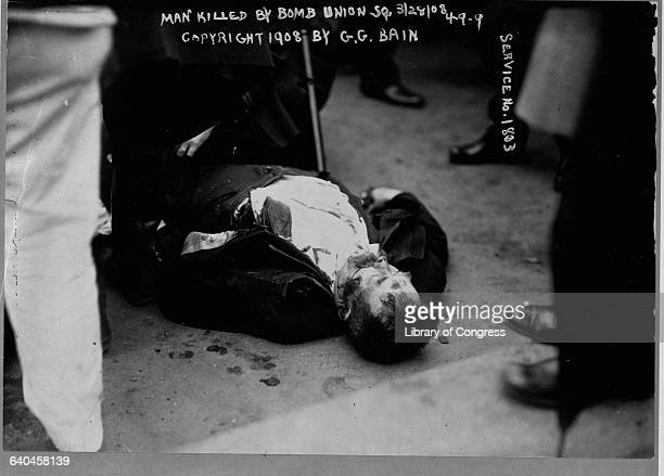 The body of man killed in a bomb explosion during an anarchist riot lies on the ground in Union Square March 1908 New York