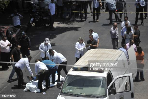 The body of Mexican journalist Javier Valdez is put on a stretcher by forensic personnel and investigators after he was shot dead in Culiacan Sinaloa...