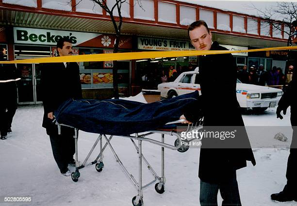The body of murdered store clerk Horacio Diogo 27 is removed from Becker's milk store where he was shot last month during a robbery that was filmed...