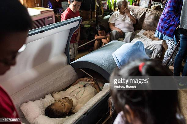 The body of Nancy Beaver who died in Anchorage in hospice care after a series of strokes is viewed by villagers on July 5 2015 in Newtok Alaska...