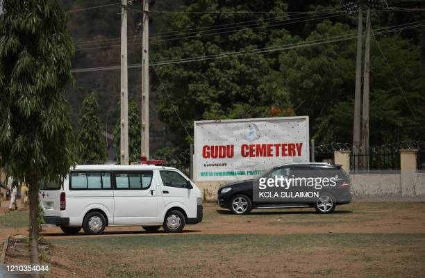 The body of Nigerias Chief of Staff , Abba Kyari, arrived in an ambulance at the Gudu Cemetery where he will be buried in Abuja on April 18, 2020. -...