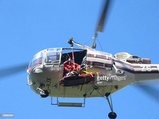 The body of Norwegian shipping magnate and wellknown mountaineer Arne Naess is lifted by members of the Wilderness Search and Rescue into the Skymed...