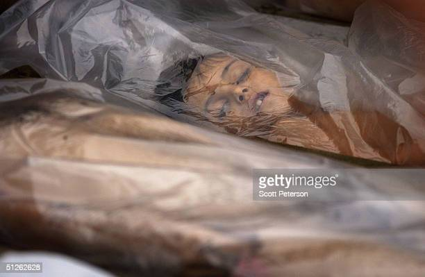 The body of one of 330 known dead lies in the city mortuary the day after the threeday Russian school siege in Beslan in which Chechen Separatists...