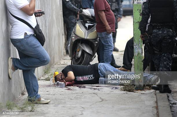 The body of one of four people killed in Acapulco Guerrero State Mexico lies on the street on May 22 2015 Guerrero is one of Mexico's poorest and...