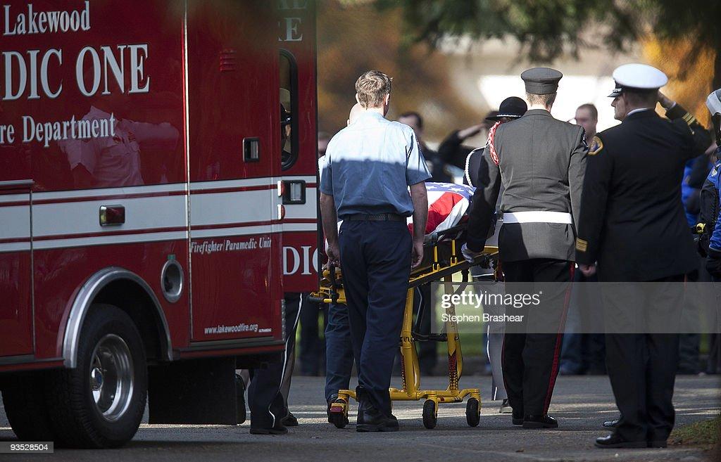 The body of one of four slain Lakewood, Washington police