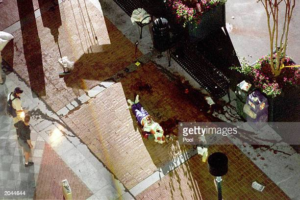 The body of one of the victims lies on ground following the bomb explosion at the AT&T Pavillion in the Centennial Olympic Park during the 1996...